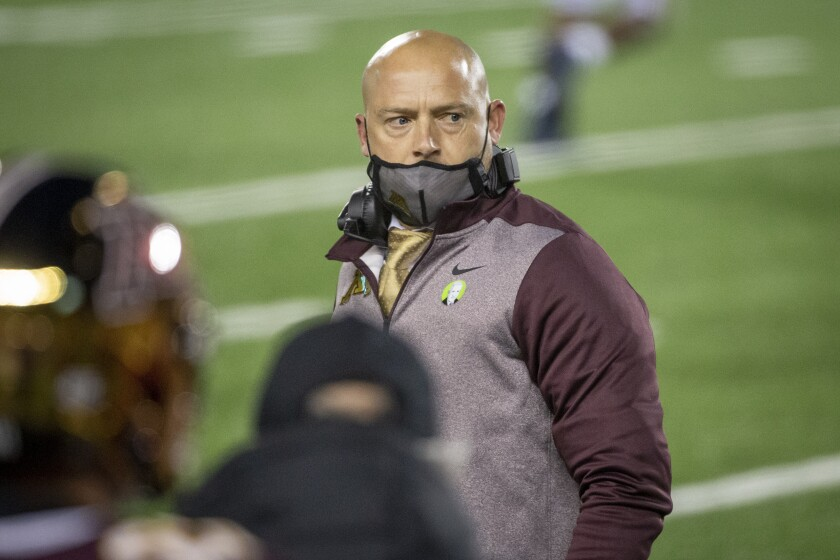 FILE - In this Oct. 24, 2020, file photo, Minnesota head coach P.J. Fleck looks at his bench during an NCAA college football game with Michigan in Minneapolis. Minnesota is among 10 of the 14 Big Ten football teams sitting at two wins entering the final weekend of the regular season. The statistical anomaly begs the question of whether it's difficult for those teams to stay motivated in a season that brought unique challenges because of the coronavirus pandemic. (AP Photo/Bruce Kluckhohn, File)