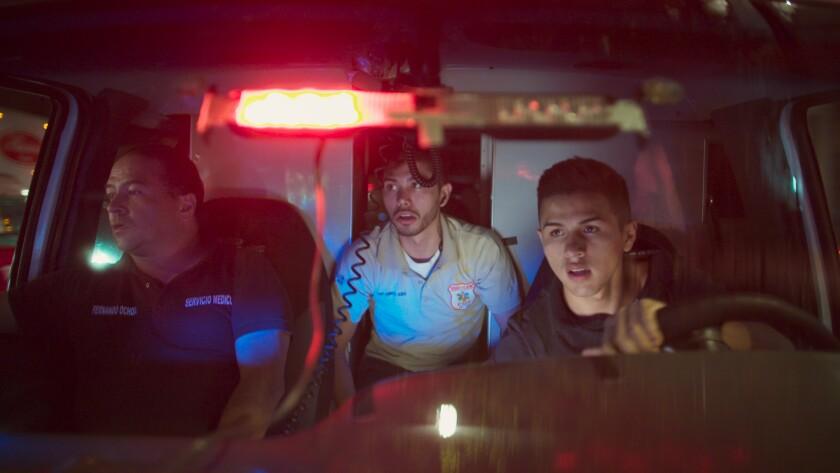"""Fernando Ochoa, Fernando Acosta and Juan Ochoa in a scene from """"Midnight Family."""""""