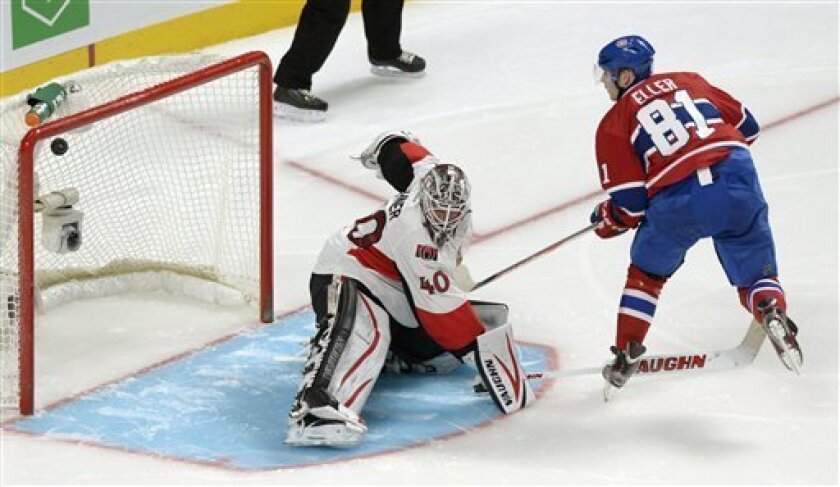 Montreal Canadiens' Lars Eller scores against Ottawa Senators goaltender Robin Lehner during the shootout in an NHL hockey game in Montreal, Wednesday, March 13, 2013. Montreal won 4-3. (AP Photo/The Canadian Press, Graham Hughes)