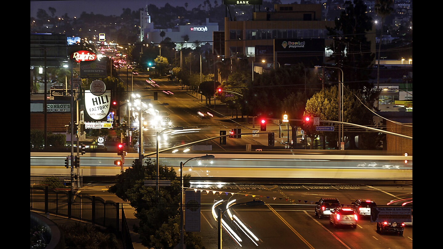 An Expo Line train crosses Crenshaw Boulevard at Exposition Boulevard in the Crenshaw District.