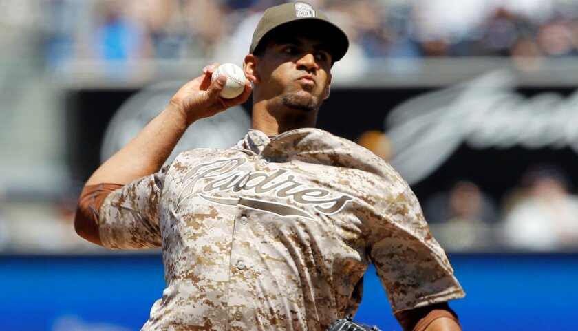 Padres starting pitcher Tyson Ross throws against the San Francisco Giants during the first inning of a baseball game in San Diego, Calif., Sunday, April 12, 2015.