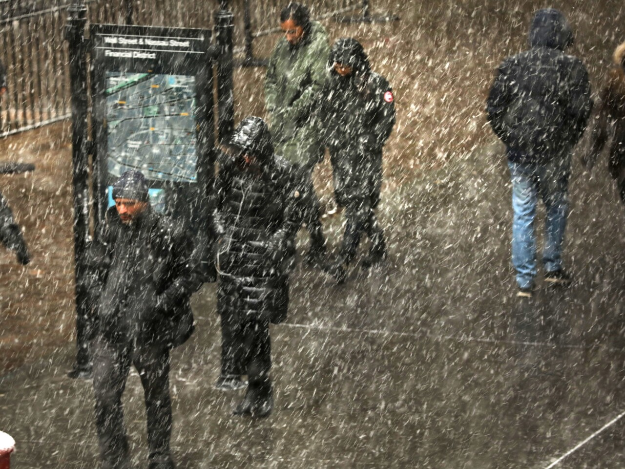 People walk through the snow in lower Manhattan as extremely cold temperatures are predicted for New York City in the coming days as a Polar Vortex, which is now over parts of the midwest, heads towards the region.