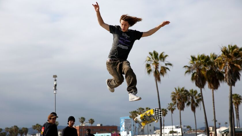 LOS ANGELES, CA-MAY 7, 2019: Ethan DeMoulin attempts to jumpover a gap at Venice Skate Park on May