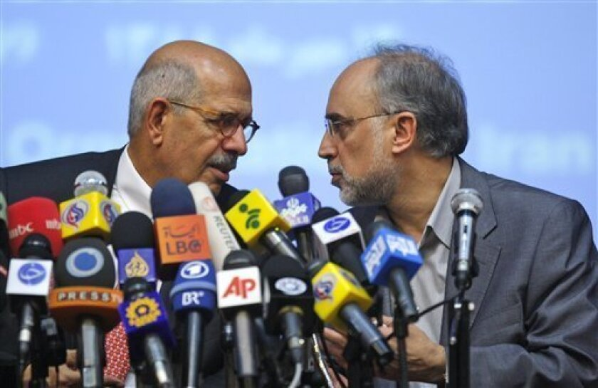 """Head of the International Atomic Energy Agency, Mohamed ElBaradei, left, speaks with the head of Iran's Atomic Energy Organization, Ali Akbar Salehi, during their joint press conference in Tehran, Iran, Sunday, Oct. 4, 2009. The head of the U.N.'s nuclear watchdog on Sunday described a """"shifting of gears"""" in the controversy over Iran's nuclear program and said inspectors would visit the country's new uranium processing site Oct. 25. ElBaradei spoke in Tehran following talks with Iranian officials over the recently revealed facility that has caused consternation around to world over the extent and purpose of Iran's nuclear program. (AP Photo/Vahid Salemi)"""