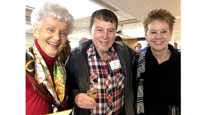 Joyce Ruygrok, left, visits with Robert Moore and Amy Ross during the Jan. 13 art opening at USC Ver
