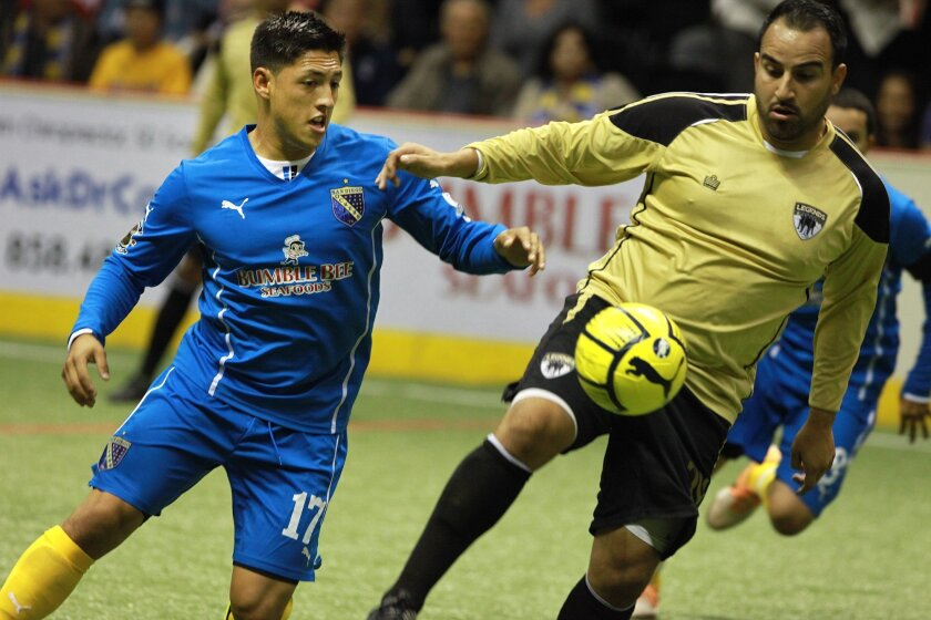 San Diego Sockers forward Raymundo Reza (left) and Las Vegas Legends' Ivan Campos look for possession of the ball Saturday.