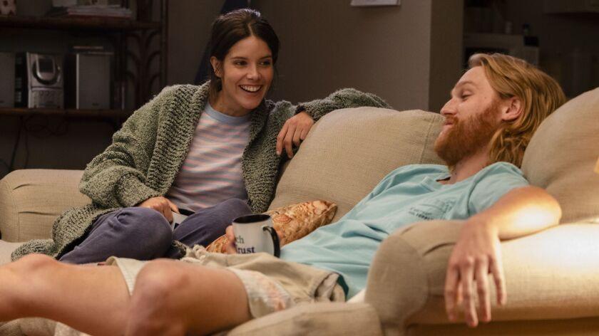 "(L-R) - Sonya Cassidy as Liz Dudley, Wyatt Russell as Sean ""Dud"" Dudley in a scene from ""Lodge 49"" _"