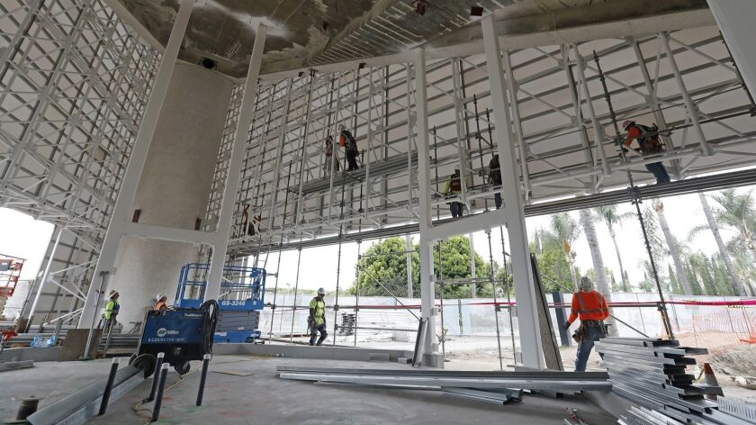 Work continuses inside the baptistry at Christ Cathedral in Garden Grove on Friday, May 11.