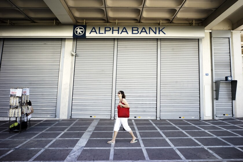 Banks were shuttered in Athens on Monday. To prevent another run on euro deposits, Greece ordered a weeklong bank closure, and residents were limited to about $66 in cash withdrawals from ATMs per day.