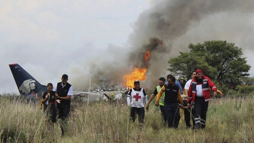 Survivors said the Embraer 190 plane burst into flames right after it hit the ground.