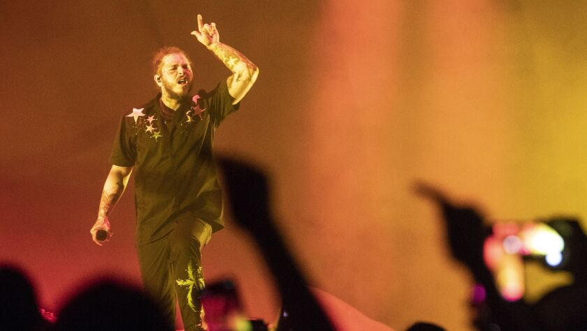 Review: Post Malone was hip-hop's saddest champion at the
