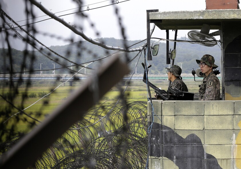 South Korean army soldiers stand guard at a military check point at the Imjingak Pavilion near the border village of Panmunjom. South Korean border guards arrested an American man who they believe was attempting to swim across a river into North Korea.