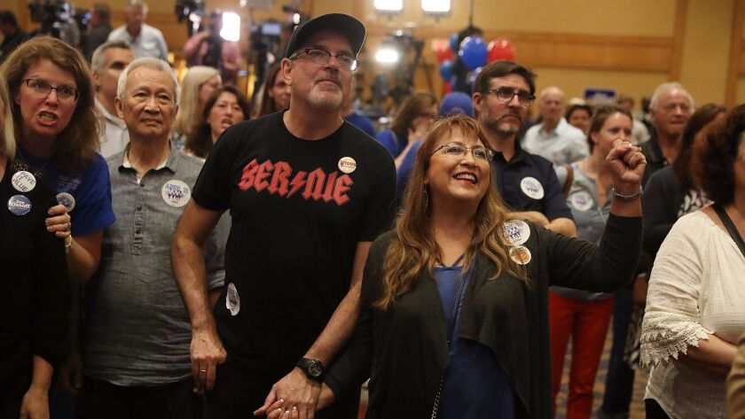 ATLANTA, GA - APRIL 18: Supporters react as early return numbers show that Democratic candidate Jon