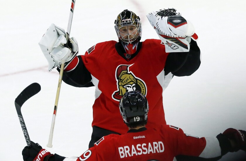 Senators goalie Craig Anderson (41) celebrates with teammate Derick Brassard (19) after Ottawa defeated the Montreal Canadiens, 4-3, in a shootout on Oct. 15.