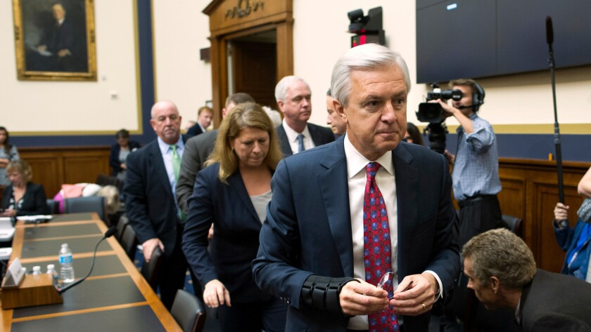 Wells Fargo CEO John Stumpf leaves a hearing room on Capitol Hill on Sept. 29 after testifying before the House Financial Services Committee, which was investigating Wells Fargo's opening of unauthorized customer accounts.