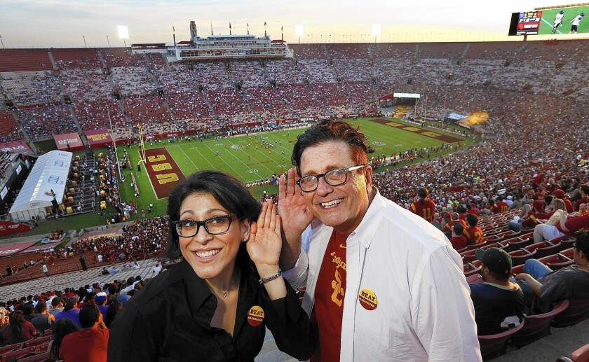 Elizabeth Valmont, an acoustical consultant, and university architect Jon Soffa, attend a USC football game this month at the Los Angeles Memorial Coliseum.