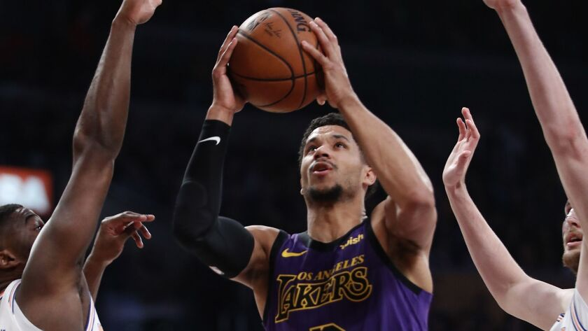Lakers guard Josh Hart tries to score against the Knicks on Friday night.