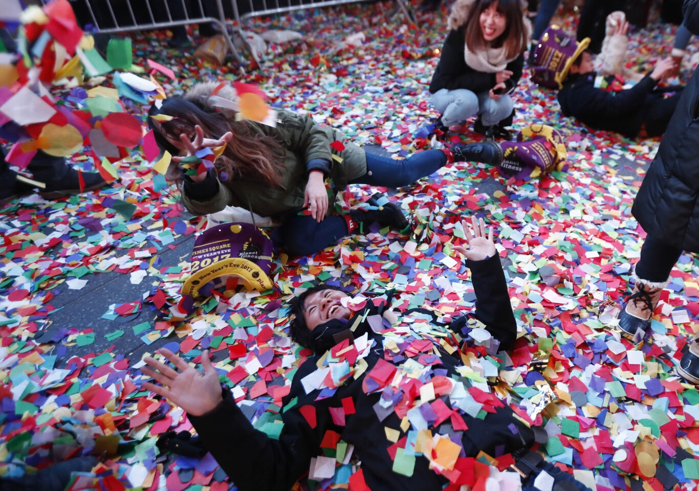 Revelers enjoy the confetti in Times Square.
