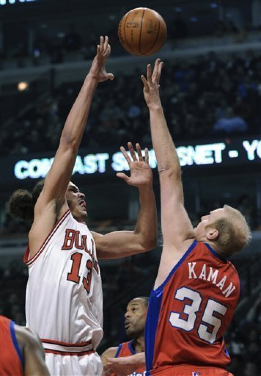 Chicago Bulls' Joakim Noah left, goes up for a shot against Los Angeles Clippers' Chris Kaman in the first quarter during an NBA basketball game in Chicago, Tuesday, Feb. 2, 2010. (AP Photo/Paul Beaty)