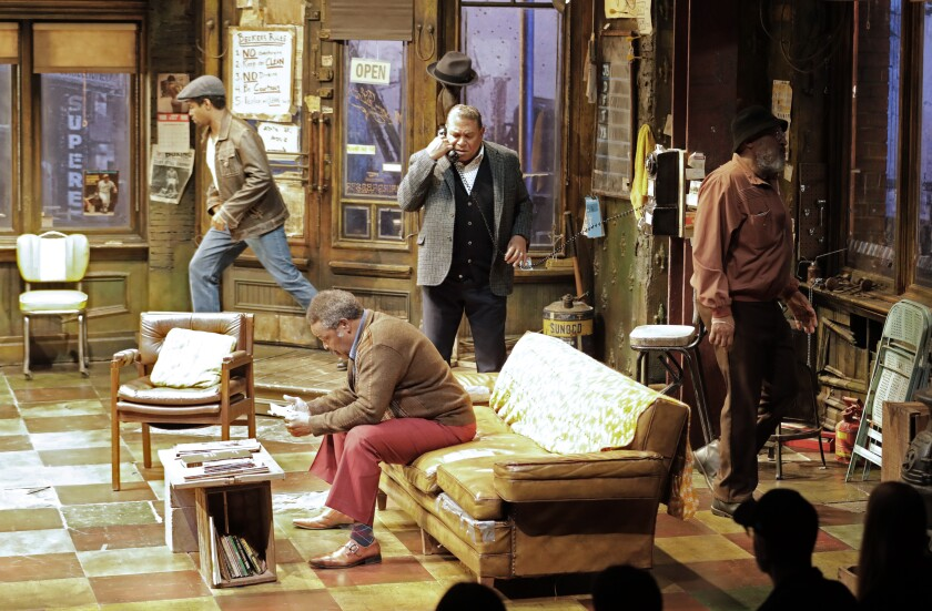 "Ray Anthony Thomas (seated) along with, from left, Amari Cheatom,  Keith Randolph Smith and Steven Anthony Jones in August Wilson's ""Jitney"" directed by Ruben Santiago-Hudson at the Mark Taper Forum."