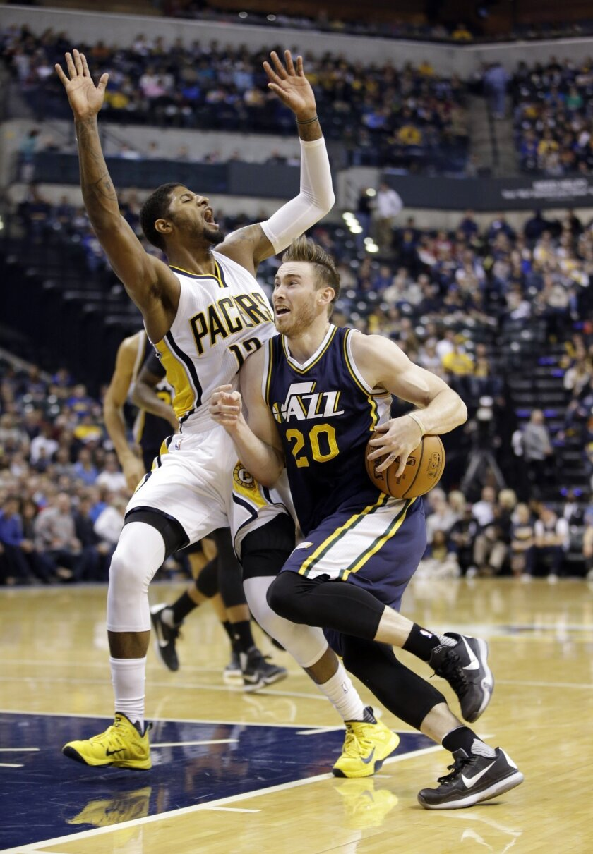 Utah Jazz's Gordon Hayward (20) is called for a foul as he goes to the basket against Indiana Pacers' Paul George (13) during the second half of an NBA basketball game Saturday, Oct. 31, 2015, in Indianapolis. The Jazz won the game 97-76. (AP Photo/Darron Cummings)