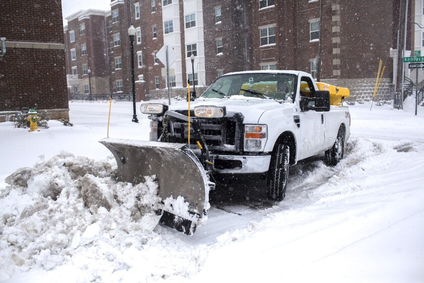 A WKU plow clears 13th Street on Friday, Jan. 22, 2016, in Bowling Green, Ky. A massive blizzard began dumping snow on the southern and eastern United States on Friday, with mass flight cancelations, five states declaring states of emergency and more than two feet (60 centimeters) predicted for Washington alone. Blizzard warnings or watches were in effect along the storm's path, from Arkansas through Tennessee and Kentucky to the mid-Atlantic states and as far north as New York. (Austin Anthony/Daily News via AP) MANDATORY CREDIT