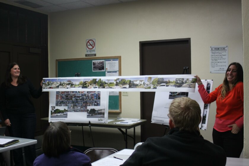 Sasha Varone and Rebecca Marquez show what the Smollen Homes project would look like in relation to its neighbors.
