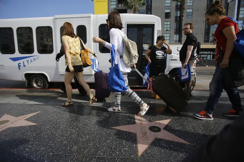 LAX FlyAway bus on Hollywood Boulevard