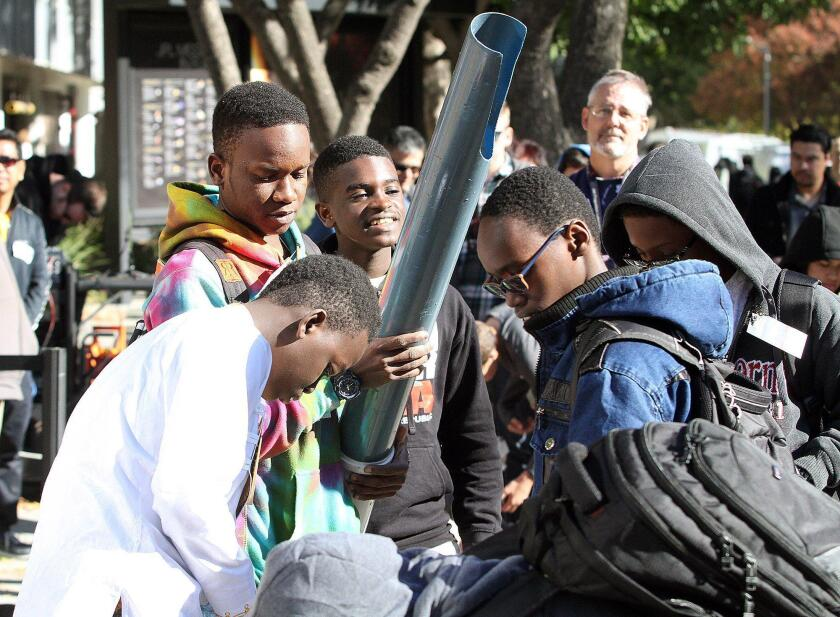 A team from Tanzania brings their invention into the competitor's square at JPL's annual Invention Challenge on Friday.