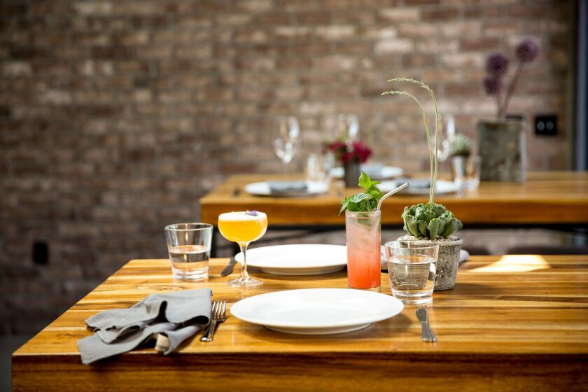 A table with cocktails at Local Kitchen + Wine Bar, opening soon in Santa Monica.