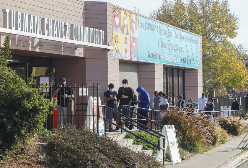 People line up for free COVID-19 testing at the Tubman Chavez Community Center on Tuesday, Dec. 22, 2020 in San Diego, CA