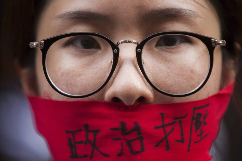 A protester calling for greater freedom of speech marches through the streets of Hong Kong on July 1 during an annual pro-democracy rally as the island marks the anniversary of the handover of sovereignty from Britain to China.
