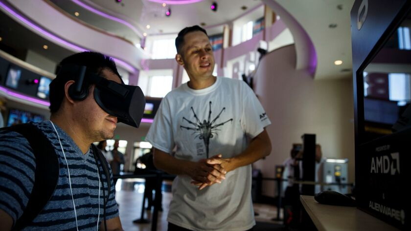 Williams Avelar tries virtual reality at Regal L.A. Live.