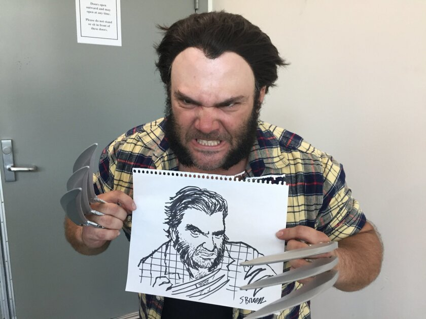 Union-Tribune editorial cartoonist Steve Breen meets with Wolverine at Comic-Con.