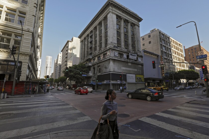 The long-vacant, graffiti-covered Merritt Building at the northwest corner of Broadway and 8th Street in downtown Los Angeles is being restored as an office building.