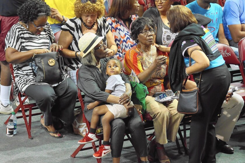 Family members of victims of Wednesday night's mass shooting at Emanuel AME Church gather for a prayer vigil at an arena in Charleston, S.C.