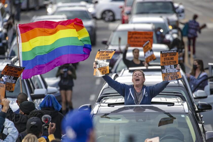 Angelenos celebrate the Biden-Harris win near City Hall on Saturday.