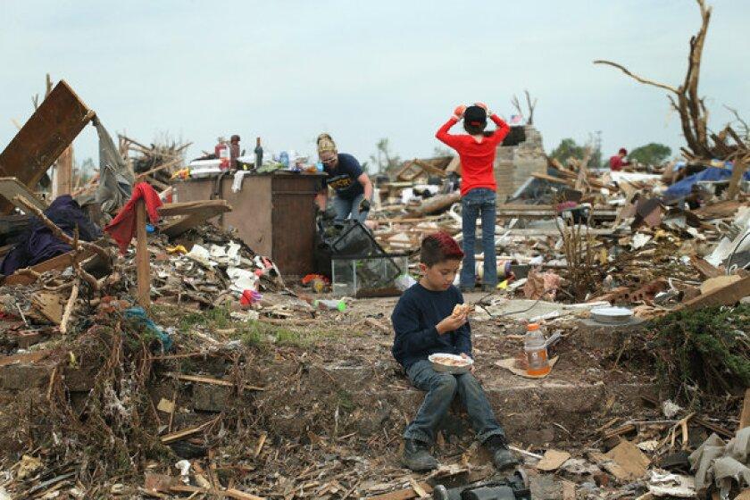 Tornado 911: 'We got hit! We've got a bunch of stuff on top of us!'