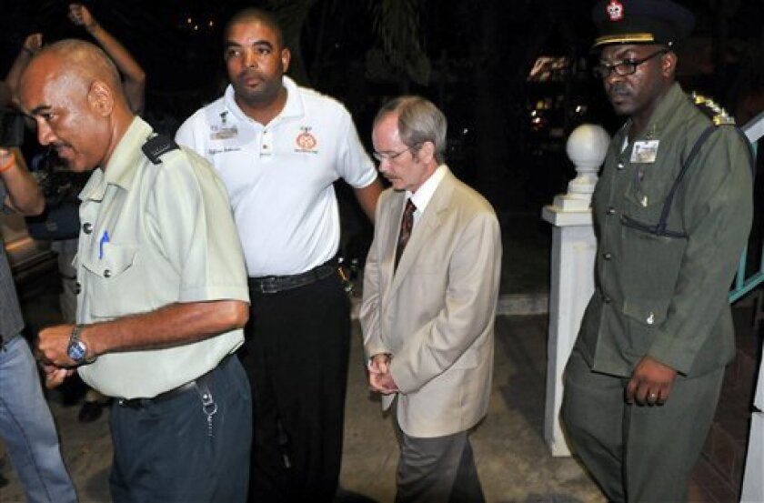U.S. citizen David Swain, second right, is escorted to the prison vehicle after being found guilty of murdering his wife during a 1999 scuba-diving trip in Tortola, British Virgin Islands, Tuesday, Oct. 27, 2009. (AP Photo/Todd VanSickle)