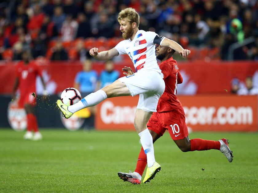 U.S. defender Tim Ream clears the ball from Canada's David Junior Hoilett during their Nations League game on Oct. 15, 2019, in Toronto.