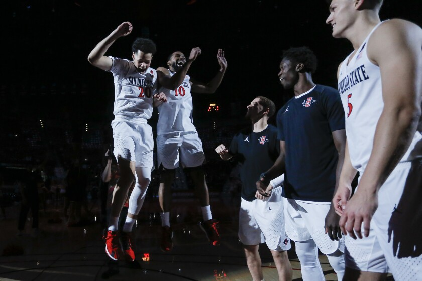 SDSU's Jordan Schakel (2) and KJ Feagin (10) jump during player introductions.
