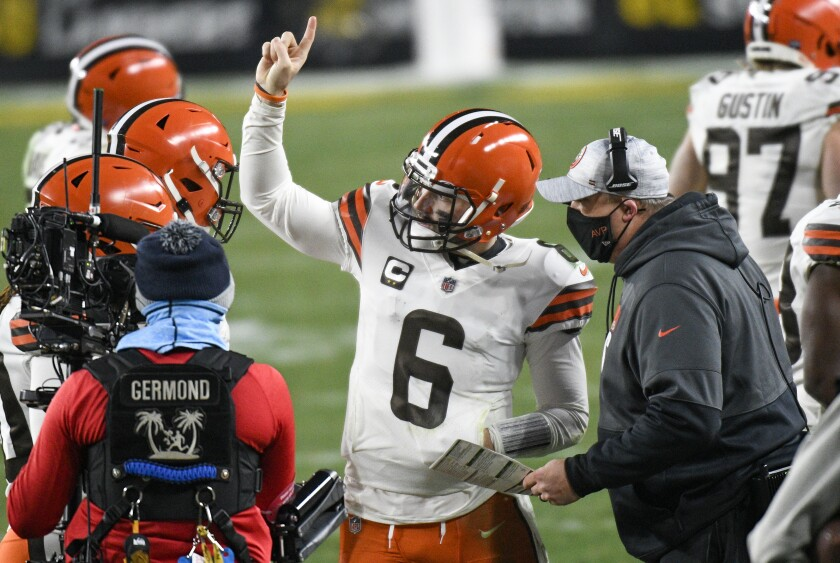 Cleveland Browns offensive coordinator Alex Van Pelt, right, talks with quarterback Baker Mayfield (6) on the sideline during the second half of an NFL wild-card playoff football game against the Pittsburgh Steelers in Pittsburgh, Sunday, Jan. 10, 2021. (AP Photo/Don Wright)