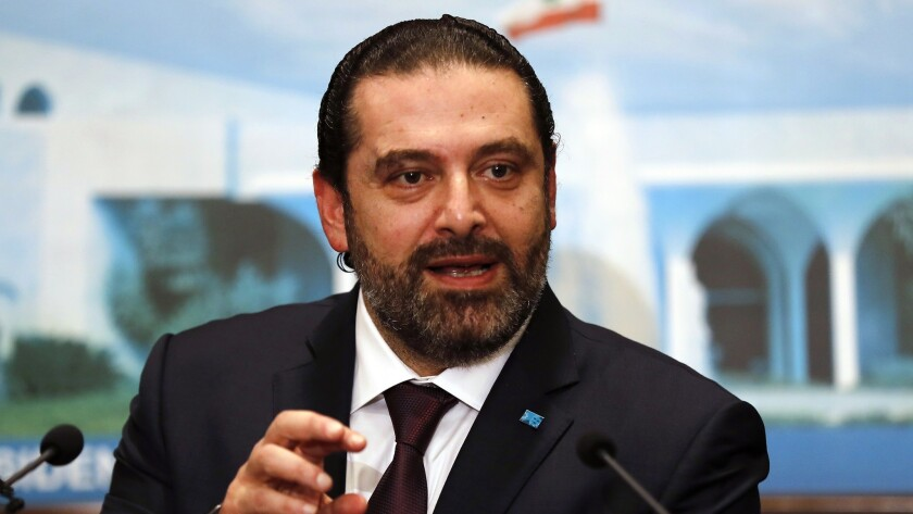 Newly appointed Lebanese Prime Minister Saad Hariri speaks to media at the presidential palace in Baabda on Thursday.