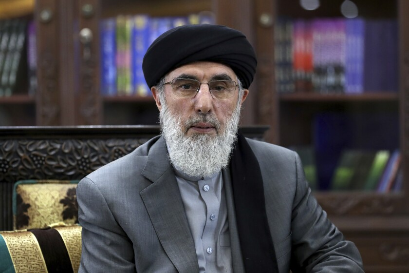 In this Sunday, Sept. 22, 2019, photo, Gulbuddin Hekmatyar, a candidate in Afghanistan's upcoming presidential election poses for a photo, in Kabul, Afghanistan. From American ally to US-declared terrorist, and now presidential candidate in Saturday's polls, Hekmatyar's past is inextricably linked to Afghanistan's volatile history. (AP Photo/Ebrahim Noroozi)