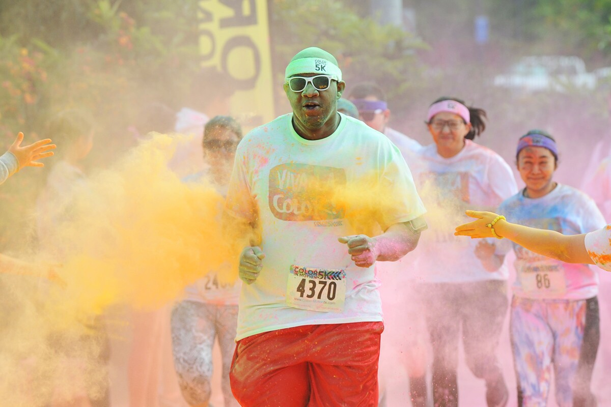 Colorful powders were thrown at runners during the Color in Motion 5K on Sunday, March 18, 2017 at the Qualcomm Stadium parking lot. (Rick Nocon)