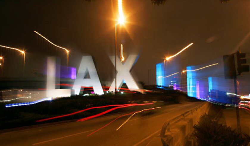 Officers served search warrants Wednesday night at LAX and other locations as part of an investigation into luggage thefts from the airport.