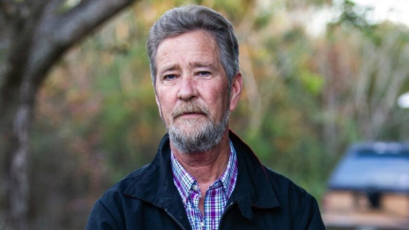 Leslie McCrae Dowless Jr. outside his home in Bladenboro, N.C., in December.