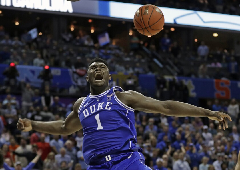 FILE - In this March 15, 2019, file photo, Duke's Zion Williamson (1) reacts after a dunk against No