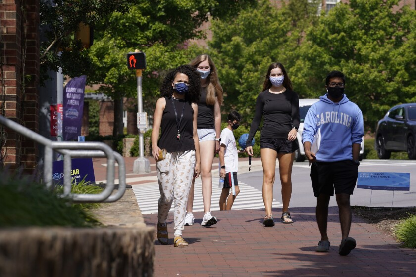 Students wear masks on campus at the University of North Carolina Chapel Hill.