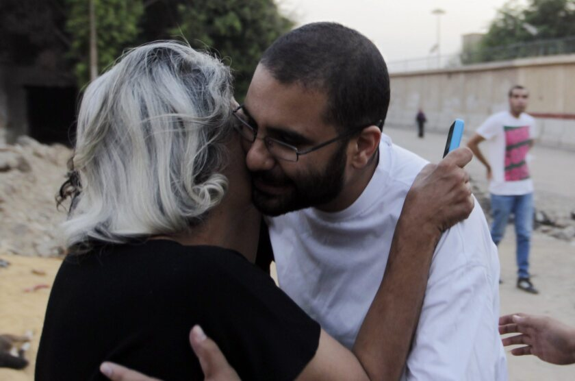 Egyptian activist Alaa Abdel Fatah is greeted by his mother, Laila Soueif, after his release from Tora prison, in Cairo.